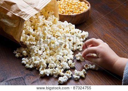 Hands Of Children Eating Popcorn