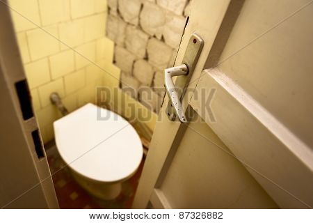 Used abandoned toilette in grungy room