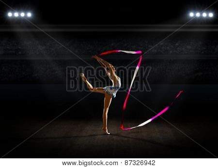 Young girl engaged art gymnastic at sports hall poster