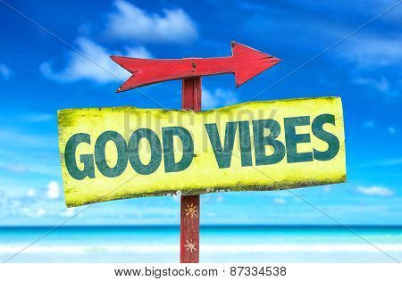 Good Vibes sign with beach background