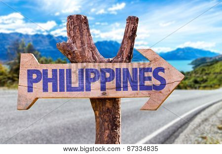 Philippines wooden sign with road background