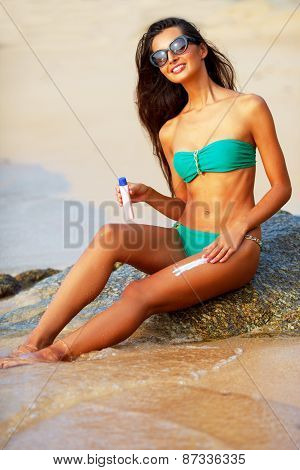 tanned brunette on the beach