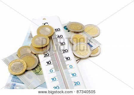 Thermometer And Money Isolated On White Background