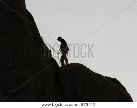 Rock Climber At Dusk.