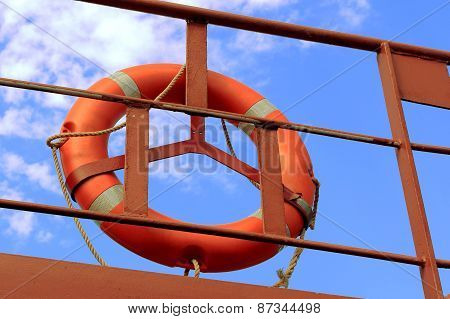 life buoy on a background of blue sky