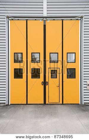 Orange Garage Door on a warehouse building