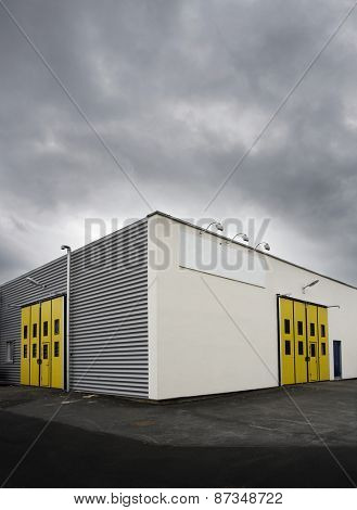 Warehouse with yellow doors at dusk