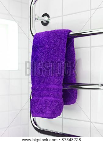 Purple Towel on a dryer in modern bathroom environment