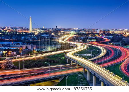 Washington D.C., skyline with highways and monuments.