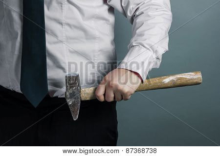 Businessman With Hammer In Hand
