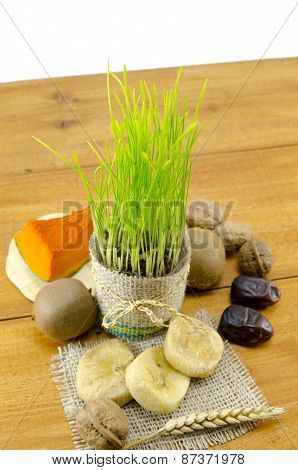 Young Green Wheat And Dried Fruit Isolated