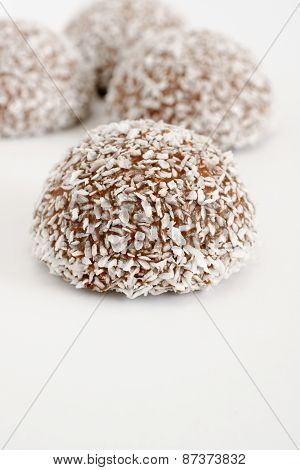 Coconut snowballs a marshmallow confection covered in chocolate and dessicated coconut poster