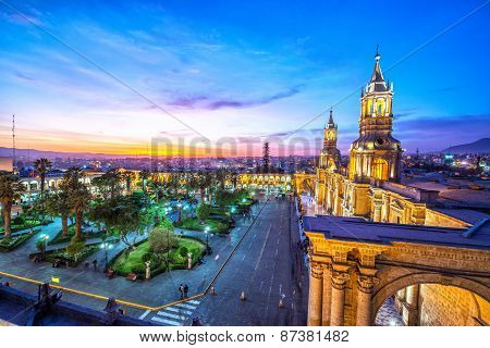 Night falling on the Plaza de Armas in the historic center of Arequipa Peru poster