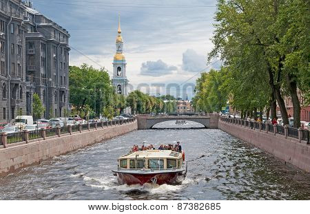 Saint-Petersburg. Russia. Tourist boat on the Kryukov Canal