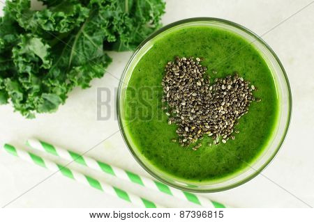 Green kale smoothie with chia seeds heart