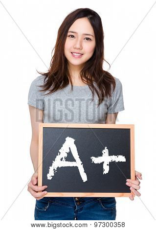 Woman hand hold with blackboard and showing mark A plus