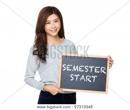 Asian woman hold with black board and showing semester start