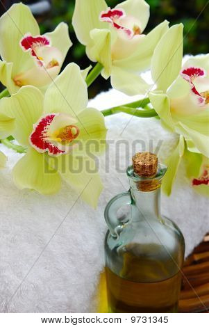 Close Up Of Massage Oil And Orchids
