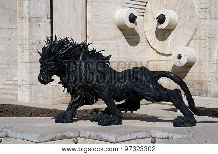 Lion art statue made from old car tyres near Yerevan Cascade giant stairway in Erevan, Armenia