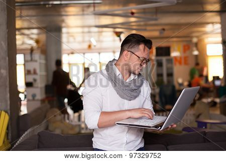 Stylish Man Using Smartphone In Startup Office