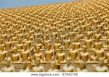 Million golden Buddha figurine in Wat Phra Dhammakaya. Buddhist temple in Bangkok Thailand poster