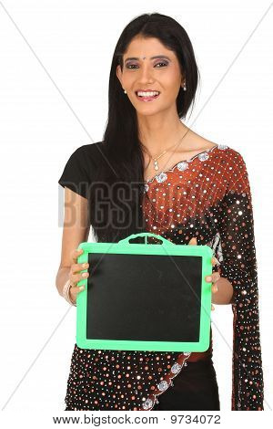 Woman in sari holding slate