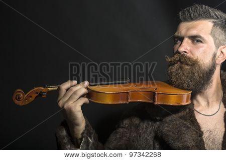 Man In Fur Coat With Violin