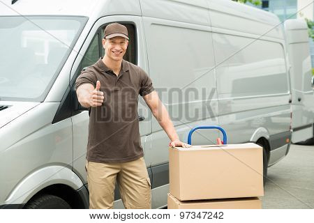 Delivery Man With Cardboard Boxes Showing Thumbs Up Sign