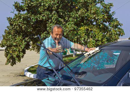 driver washing a car