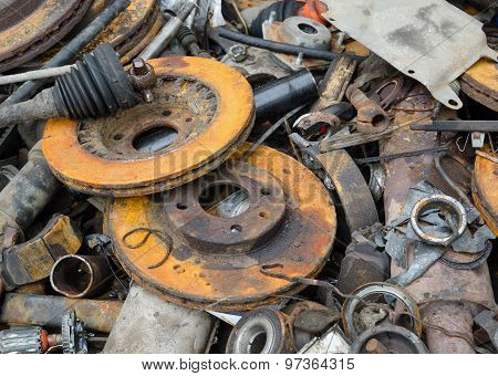 Useless, worn out rusty brake discs and other parts poster