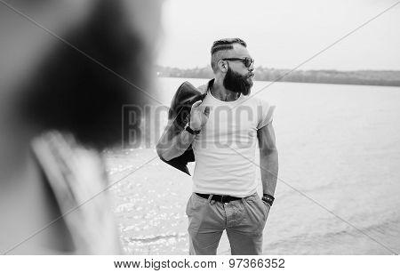 bearded man on the beach