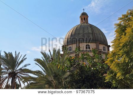 Basilica on Mount of Beatitudes. Israel, lake Tiberias. The majestic dome is surrounded by magnificent park