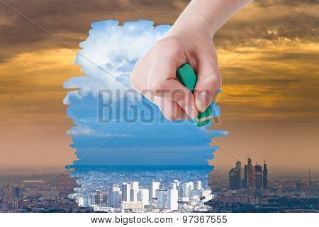 Hand Deletes Smog Urban Landscape By Eraser