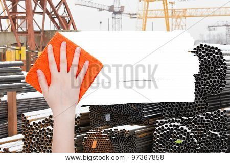 ecology concept - hand deletes industrial landscape by orange rag from image and white empty copy space are appearing poster