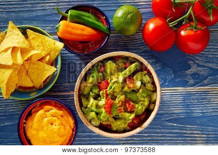 Mexican food nachos guacamole pico de gallo and dipping cheddar cheese