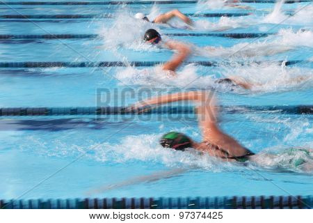Freestyle swimmer. Motion blurred image