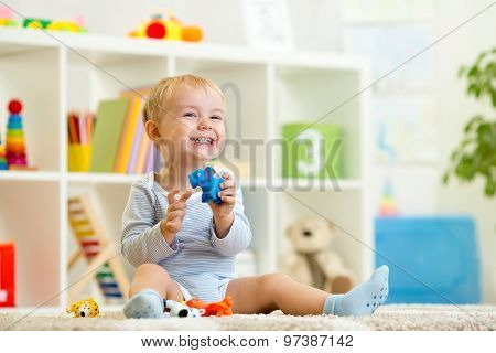 happy child holding elefant toy