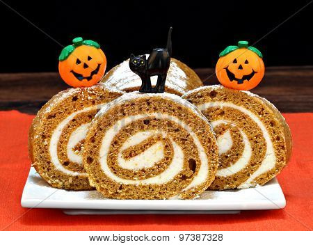 Pumpkin Roll Cake Decorated For Halloween