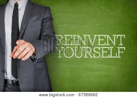 Reinvent yourself on blackboard with businessman