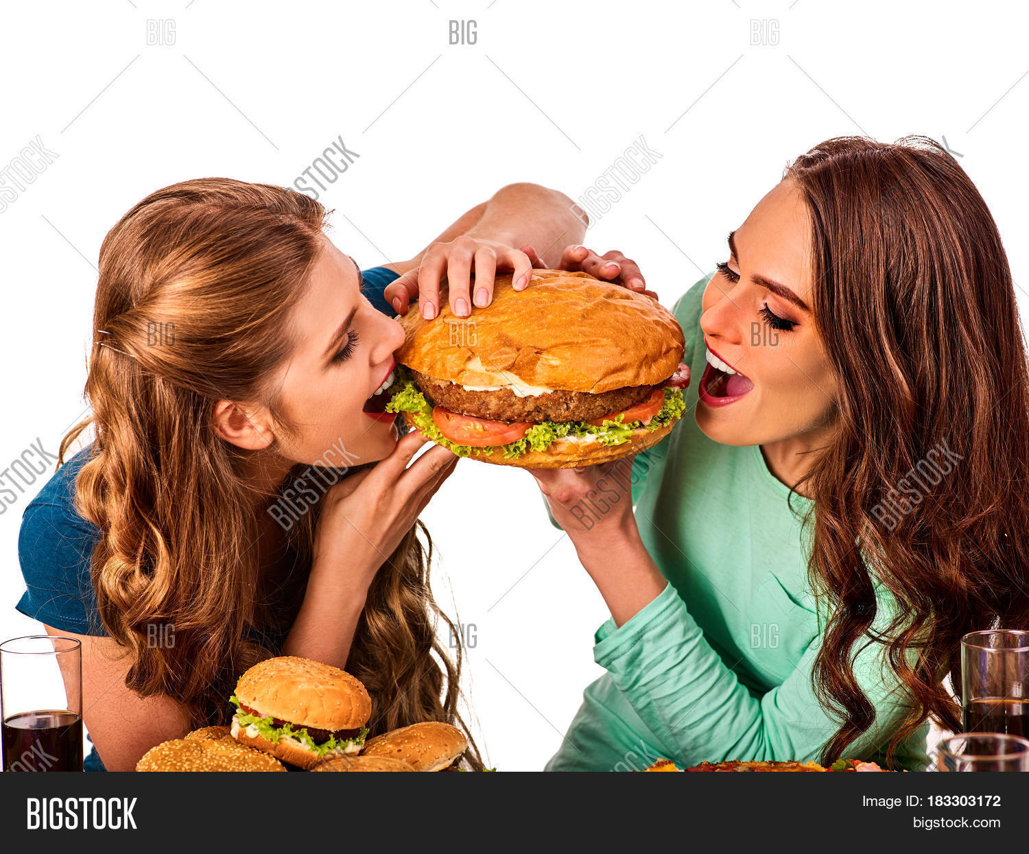 Two girls eating eachother