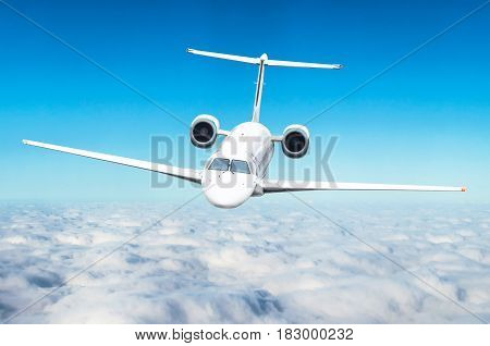 Airplane On Flight Level Above The Clouds In The Blue Sky