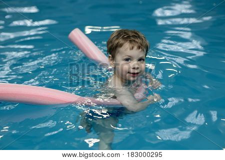 Kid With Pool Noodles