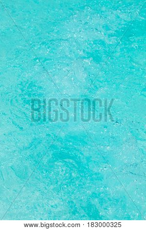 Clear background swimming pool rippled water detail.
