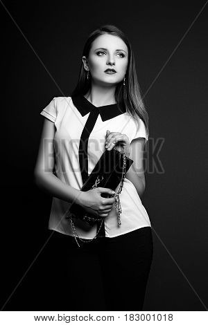 Studio Photo Of Young  Woman On Black Background. Black And White.