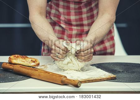 Hands Closeup Of A Chef Who Makes The Dough In The Kitchen