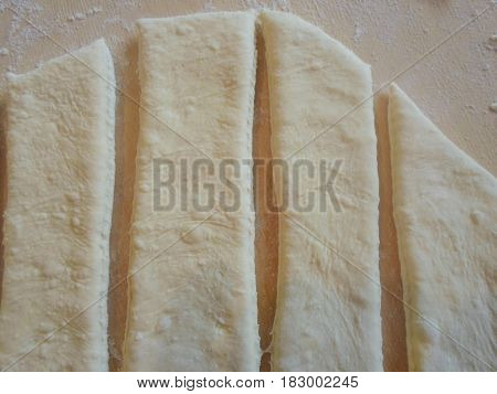 Wooden board with flour and dough. Background. Vertical lines