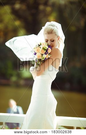 Portrait of the beautiful bride in the windy weather