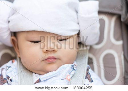 Asian Baby Infant Enjoy Drinking Water From Bottle