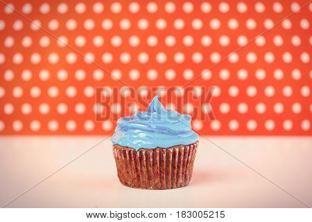 photo of tasty delicious cupcake on the wonderful dotted background in pop art style