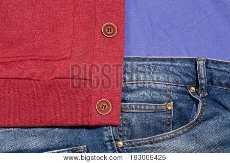 Photo Of Cool Fashionable Look Of Jeans, Shirt And Cardigan In Close-up